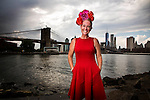 New York, Sept 9, 2015. Broome milliner Felicty Brown is showing a range of her hats at New York Fashion Week on Friday, she is pictured in Brooklyn looking back towards Manhattan. photo by Trevor Collens.