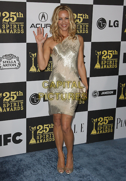 MARIA BELLO .25th Annual Film Independent Spirit Awards held At The Nokia LA Live, Los Angeles, California, USA,.March 5th, 2010 ..arrivals Indie Spirit full length hand waving gold nude beige cream one shoulder shiny dress peep toe shoes clutch bag .CAP/ADM/KB.©Kevan Brooks/Admedia/Capital Pictures