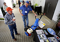 NWA Democrat-Gazette/DAVID GOTTSCHALK  Wayne Whitmore (left), of Coyle Okla., speaks with Jim Shaw, with Cedar Farm and BCS Tractor Sales of Sands Springs, Okla., discusses the BCS Two Wheel Tractor Friday, January 4, 2019, at the 2019 Horticulture Industries Show at the Chancellor Hotel in Fayetteville. The show continues today from 9:00 a.m. to 12:00 p.m.