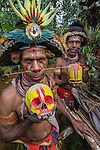Huli wigmen with painted skulls, Papua New Guinea