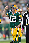 Green Bay Packers quarterback Aaron Rodgers (12) celebrates a touchdown after an official overturned the call during a Week 4 NFL football game against the Denver Broncos on October 2, 2011 in Green Bay, Wisconsin. The Packers won 49-23. (AP Photo/David Stluka)