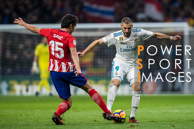 Karim Benzema of Real Madrid vies for the ball with Stefan Savic of Atletico de Madrid  during the La Liga 2017-18 match between Atletico de Madrid and Real Madrid at Wanda Metropolitano  on November 18 2017 in Madrid, Spain. Photo by Diego Gonzalez / Power Sport Images