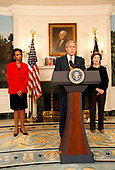 United States President George W. Bush announces he will widen economic sanctions on Myanmar's military rulers, piling on pressure for a transition to democracy after a bloody crackdown on anti-junta protests, in the Diplomatic Room of the White House in Washington, DC on October 19, 2007. The move comes only days after the European Union increased its sanctions against the regime. Standing with the President are US Secretary of State Condoleezza Rice, left, and first lady Laura Bush, right.<br /> Credit: Aude Guerrucci / Pool via CNP