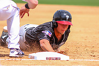 Lansing Lugnuts outfielder Ryan Noda (19) dives back into first base during a Midwest League game against the Wisconsin Timber Rattlers on May 8, 2018 at Fox Cities Stadium in Appleton, Wisconsin. Lansing defeated Wisconsin 11-4. (Brad Krause/Four Seam Images)