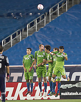 Seattle Sounders wall, Servando Carrasco, Nate Jaqua, Alvaro Fernandez, Roger Levesque, Fredy Montero, reacts. In a Major League Soccer (MLS) match, the Seattle Sounders FC defeated the New England Revolution, 2-1, at Gillette Stadium on October 1, 2011.