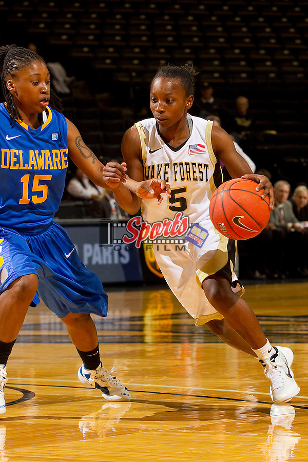 Chelsea Douglas #5 of the Wake Forest Demon Deacons drives the lane past Akeema Richards #15 of the Delaware Blue Hens at the LJVM Coliseum on December 11, 2011 in Winston-Salem, North Carolina.  The Blue Hens defeated the Demon Deacons 70-57.    (Brian Westerholt / Sports On Film)