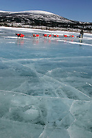 Monday March 12, 2007   ----   Robert Sorlie runs on a frozen tundra lake between Unalakleet and Shaktoolik.