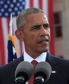United States President Barack Obama delivers remarks at the Pentagon Memorial in Washington, DC during an observance ceremony to commemorate the 15th anniversary of the 9/11 terrorist attacks, Sunday, September 11, 2016.<br /> Credit: Dennis Brack / Pool via CNP
