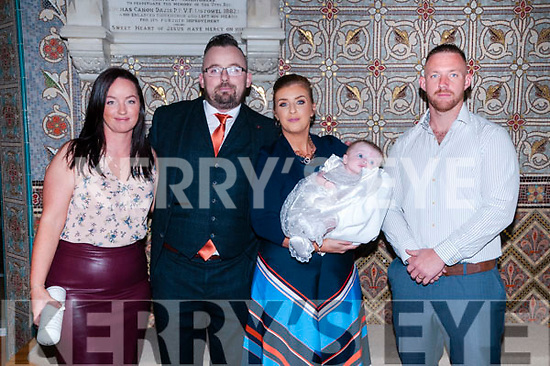 Baby  Farrah McAuliffe with her parents David McAulliffe & Rhona Enright, Listowel and god parents Linda McAulliffe & Martin Enright who was christened in St. Mary's Church. Listowel by Canon Declan O'Connor on Saturday last and afterwards at Mermaids  Bar, Listowel.