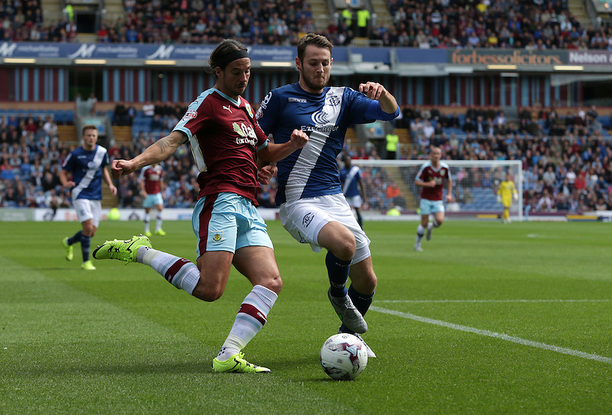 Burnley's George Boyd crosses the ball despite the attentions of Birmingham City's Jonathan Grounds<br /> <br /> Photographer Stephen White/CameraSport<br /> <br /> Football - The Football League Sky Bet Championship - Burnley v Birmingham City - Saturday 15th August 2015 - Turf Moor - Burnley<br /> <br /> &copy; CameraSport - 43 Linden Ave. Countesthorpe. Leicester. England. LE8 5PG - Tel: +44 (0) 116 277 4147 - admin@camerasport.com - www.camerasport.com
