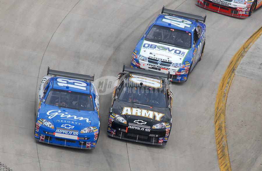 Apr 1, 2007; Martinsville, VA, USA; Nascar Nextel Cup Series driver Joe Nemechek (13) races alongside teammate Regan Smith (01) and Mike Bliss (49) during the Goody's Cool Orange 500 at Martinsville Speedway. Martinsville marks the second race for the new car of tomorrow. Mandatory Credit: Mark J. Rebilas