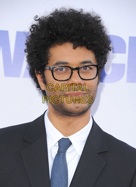 Richard Ayoade.The L.A. Premiere of 'The Watch' held at The Grauman's Chinese Theatre in Hollywood, California, USA..July 23rd, 2012  .headshot portrait black suit blue tie white shirt glasses stubble facial hair                                                                               .CAP/RKE/DVS.©DVS/RockinExposures/Capital Pictures.