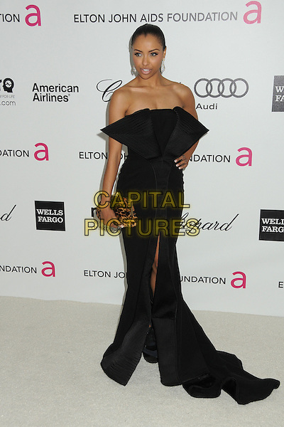 Kat Graham.20th Annual Elton John Academy Awards Viewing Party held at West Hollywood Park, West Hollywood, California, USA..February 26th, 2012.full length black strapless dress slit split  hand on hip brown leopard print clutch bag.CAP/ADM/BP.©Byron Purvis/AdMedia/Capital Pictures.