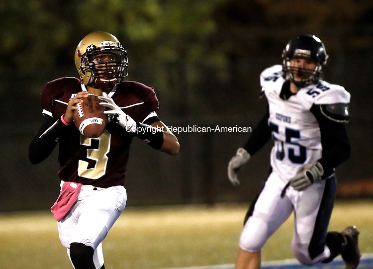 Waterbury, CT- 30 October 2014-103014CM07- Sacred Heart/Kaynor's Quincy Williams scrambles with the ball as Oxford's Noah Lisewski (55) gives chase during their matchup in Waterbury on Thursday.   Christopher Massa Republican-American