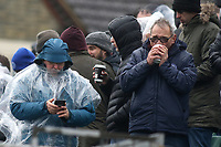 A Peterborough fan enjoys a hot drink at half-time on a cold afternoon at Gillingham FC during Gillingham vs Peterborough United, Sky Bet EFL League 1 Football at the MEMS Priestfield Stadium on 10th February 2018