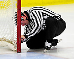 18 October 2009: An NCAA Hockey East official checks the netting at a goalpost after a goal was dissalowed for entering the net from the side of the net during the first period of a game between the University of Vermont Catamounts and the Boston College Eagles at Gutterson Fieldhouse in Burlington, Vermont. The Catamounts defeated the Eagles 4-1 to open Vermont's America East hockey season. Mandatory Credit: Ed Wolfstein Photo