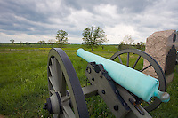 Gettysburg National Military Park, PA<br /> Storm clouds over a cannon on Cemetery Ridge