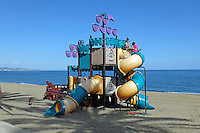 Children&rsquo;s slide, beach, San Pedro de Alcantara, Marbella, Spain, March, 2016, 201603062381<br />