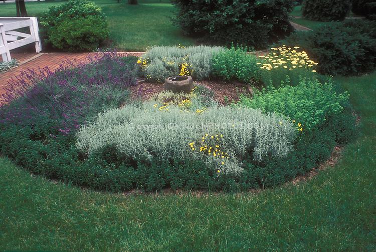 Revolutionary War-Era herb garden with Indian mortar stone centrepiece. 10' x 10' circular herb layout of lavender, santonlina, yarrow, marjoram, creeeping thyme, germander border.