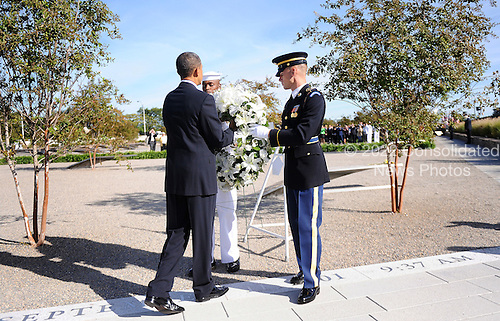 United States President Barack Obama  participates in a wreath laying ceremony and moment of silence at the Pentagon Memorial to mark the 9th anniversary of the terrorist attacks, in Arlington, Virginia, Saturday, September 11, 2010..Credit: Olivier Douliery - Pool via CNP