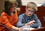 Toni Richard, of Reno, and her son Kyle, 12, testify in the Senate Finance hearing at the Legislative Building in Carson City, Nev., on Thursday, Feb. 12, 2015. Richard, and her two sons who are autistic, urged lawmakers not to cut funding to state autism programs.<br /> Photo by Cathleen Allison