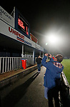 Coventry United 3 Highgate United 5, 17/10/2017. Butts Park Arena, Birmingham Senior Cup. A spectator photographs the scoreboard, showing the final score  Coventry United 3 Highgate United 5.  Photo by Paul Thompson.
