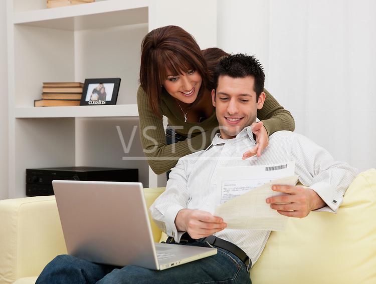 USA, Illinois, Metamora, Couple using laptop on sofa