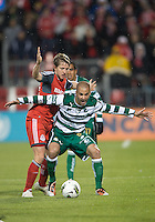 28 March 2012: Toronto FC defender Ty Harden #20 and Club Santos Laguna Marc Crosas #6 in action during a CONCACAF Champions League game between the Club Santos Laguna and Toronto FC at BMO Field in Toronto...