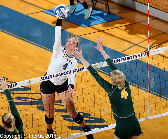 BROOKINGS, SD - SEPTEMBER 24: Ashlynn Smith #4 from South Dakota State looks to get a kill past Brianna Rasmusson #4 from North Dakota State during their match Sunday evening at Frost Arena in Brookings. (Photo by Dave Eggen/Inertia)