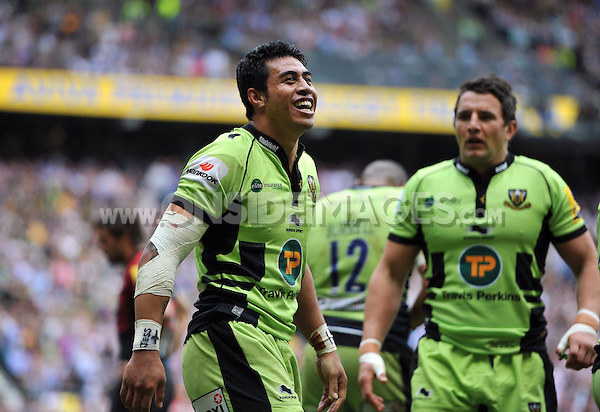 George Pisi is all smiles after scoring a try for Northampton Saints. Aviva Premiership Final, between Saracens and Northampton Saints on May 31, 2014 at Twickenham Stadium in London, England. Photo by: Patrick Khachfe / JMP