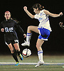 Nassau Team No. 24 Julia Beattie (Carle Place HS) redirects a kick during the second of two Long Island varsity girls' soccer senior all-star games against Suffolk at Bethpage High School on Friday, November 27, 2015.<br /> <br /> James Escher