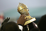 Members of the Manatee Mustangs reach out to touch their trophy after winning the Midget Division II title during the Pop Warner Super Bowl at Disney's Wide World of Sports complex in Orlando, FL, Friday, Dec. 9, 2005.(AP Photo/Brian Myrick)