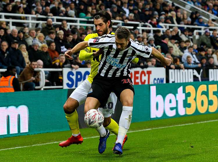 Newcastle United's Florian Lejeune shields the ball from Blackburn Rovers' Danny Graham<br /> <br /> Photographer Alex Dodd/CameraSport<br /> <br /> Emirates FA Cup Third Round - Newcastle United v Blackburn Rovers - Saturday 5th January 2019 - St James' Park - Newcastle<br />  <br /> World Copyright © 2019 CameraSport. All rights reserved. 43 Linden Ave. Countesthorpe. Leicester. England. LE8 5PG - Tel: +44 (0) 116 277 4147 - admin@camerasport.com - www.camerasport.com