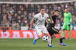 Lucas Vazquez of Real Madrid fights for the ball with Lorenzo Insigne of SSC Napoli during the match Real Madrid vs Napoli, part of the 2016-17 UEFA Champions League Round of 16 at the Santiago Bernabeu Stadium on 15 February 2017 in Madrid, Spain. Photo by Diego Gonzalez Souto / Power Sport Images