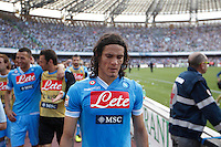 Napoli's Uruguayan forward Edinson Cavani cries as he celebrates victory and the qualification of the SSC Napoli team in the UEFA Champions League during the Italian Serie A football match between SSC Napoli and Siena at the San Paolo stadium in NaplesNAPOLI CACIO FESTA QUALIFICAZIONE  CHAMPIONS