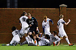 GREENSBORO, NC - DECEMBER 02: Ben Haines #14 of Messiah College celebrates with teammates after scoring against North Park University during the Division III Men's Soccer Championship held at UNC Greensboro Soccer Stadium on December 2, 2017 in Greensboro, North Carolina. Messiah College defeated North Park University 2-1 to win the national title. (Photo by Grant Halverson/NCAA Photos via Getty Images)