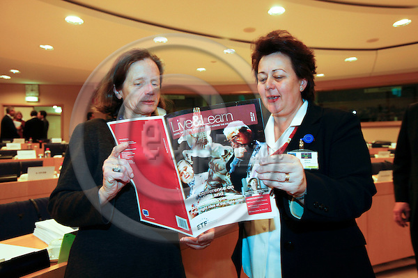 BRUSSELS - BELGIUM - 27 JANUARY 2010 -- From left MEP Pervenche BERES and Madlen SERBAN director for European Training Foundation (ETF), looking in the ETF magazine Live & Learn before the presentation of the ETF Work Programme 2010 at a meeting of the European Parliament Committee on Employment and Social Affairs. PHOTO: ERIK LUNTANG / EUP-IMAGES