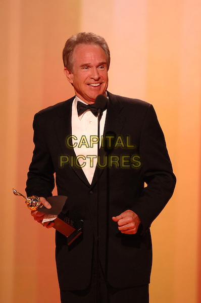 "WARREN BEATTY .Accepts the Cecille B. DeMille award.Telecast - 64th Annual Golden Globe Awards, Beverly Hills HIlton, Beverly Hills, California, USA..January 15th 2007. .globes half length black tuxedo jacket microphone trophy .CAP/AW.Please use accompanying story.Supplied by Capital Pictures.© HFPA"" and ""64th Golden Globe Awards"""