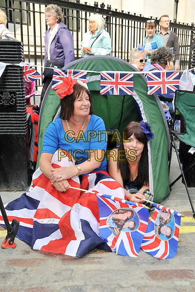 ATMOSPHERE.Wedding day for Prince William and Catherine Middleton (Kate)..April 29th, 2011.gv general view union jack flags sitting tent camp camping.CAP/MAR.© Martin Harris/Capital Pictures.