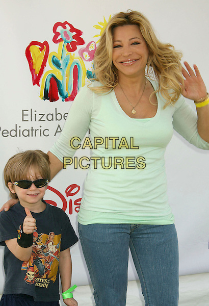 """TAYLOR DANE & SON LEVI.""""A Time For Heroes"""" Sponsored by Disney to Benefit the Elizabeth Glaser Pediatric AIDS Foundation held at Wadsworth Theater, Westwood, California, USA,.10 June 2007..half length hand family kid mother mom mum.CAP/ADM/RE.©Russ Elliot/AdMedia/Capital Pictures."""