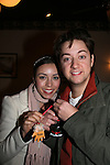 Bradford Anderson & fiance Kiera holding Christmas ornament given to them by a fan - General Hospital - appeared by way of Coastal Entertainment on December 6, 2009 at Uncle Vinny's/Ferrera's Cafe in Point Pleasant, New Jersey. They sang for the fans, answered questions, signed photos and posed for photos. (Photos by Sue Coflin/Max Photos)