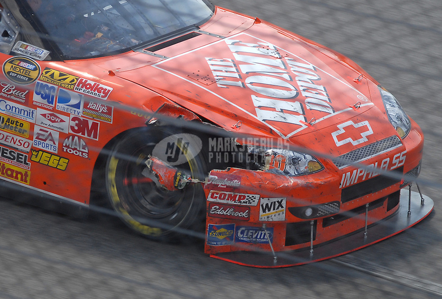 May 6, 2007; Richmond, VA, USA; Nascar Nextel Cup Series driver Tony Stewart (20) after crashing during the Jim Stewart 400 at Richmond International Raceway. Mandatory Credit: Mark J. Rebilas-US PRESSWIRE Copyright © 2007 Mark J. Rebilas..