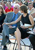 Washington, DC - October 17, 2007 -- Activist and actor Richard Gere, left, and his wife, actress Carey Lowell, listen as The 14th Dalai Lama, Tenzin Gyatso, makes a speech on the West Lawn of the United States Capitol in Washington, D.C. on Wednesday, October 17, 2007.  Earlier, inside the Rotunda of The Capitol the Dalai Lama accepted the Congressional Gold Medal, the nation's highest and most distinguished civilian award..Credit: Ron Sachs/CNP