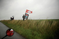 few fans holding strong against the brutal elements to cheer for their idols<br /> <br /> 2014 Tour de France<br /> stage 5: Ypres/Ieper (BEL) - Arenberg Porte du Hainaut (155km)