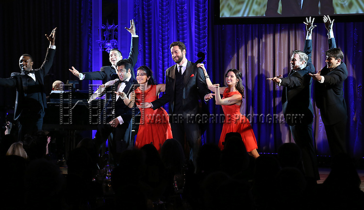 Kal Penn and Zachary Levi with dancers perform during the Drama League's 30th Annual 'Musical Celebration of Broadway' honoring Neil Patrick Harris at the Pierre Hotel on February 3, 2014 in New York City.