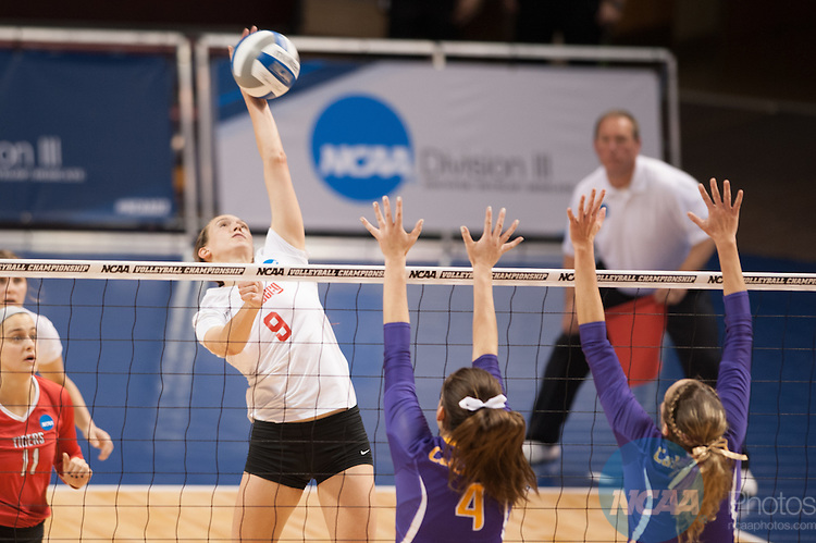 21 NOV 2015: Wittenberg's Kara Seidenstricker attempts to blast a spike past the Cal Lutheran defense during the Division III Women's Volleyball Championship held at Van Noord Arena on the Calvin University campus in Grand Rapids, MI. Cal Lutheran defeated Wittenberg 3-0 for the national title. Erik Holladay/NCAA Photos