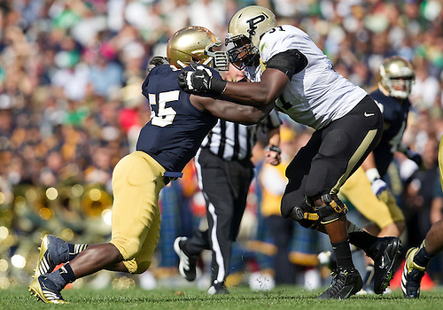 September 08, 2012:  Notre Dame outside linebacker Prince Shembo (55) and Purdue offensive tackle Justin Kitchens (51) battle at the line of scrimmage during NCAA Football game action between the Notre Dame Fighting Irish and the Purdue Boilermakers at Notre Dame Stadium in South Bend, Indiana.  Notre Dame defeated Purdue 20-17.
