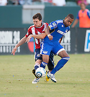 CARSON, CA – SEPTEMBER 19: Chivas USA midfielder Ben Zemanski (21) and KC Wizard forward Teal Bunbury (9) during a soccer match at Home Depot Center, September 19, 2010 in Carson California. Final score Chivas USA 0, Kansas City Wizards 2.