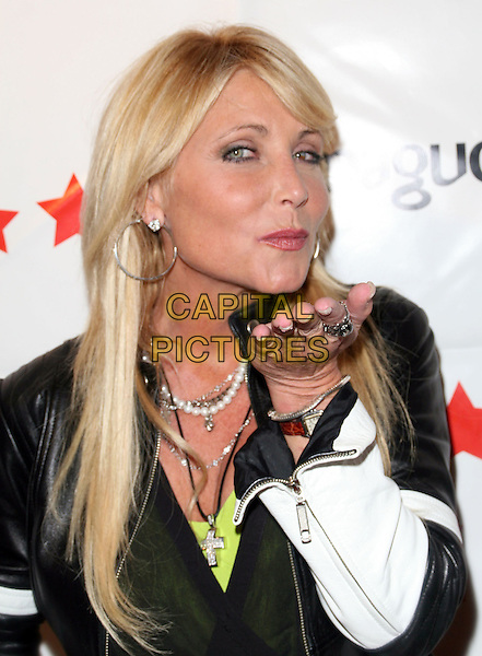 PAMELA BACH HASSELHOFF.Mosci 3rd Anniversary Party held on Melrose Avenue, Los Angeles, California, USA, 17 July 2008..portrait headshot hand blowing kiss.CAP/ADM/FS.©Faye Sadou/Admedia/Capital Pictures