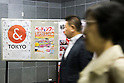 Commuters walk past a ''& TOKYO'' poster displayed in Shinjuku subway station on October 16, 2015, Tokyo, Japan. Tokyo Metropolitan Government launched a new logo as a part of the Tokyo Brand Promotion Campaign with the aim of making the city the principal tourist destination in the world ahead of the Tokyo Olympic and Paralympic games in 2020. (Photo by Rodrigo Reyes Marin/AFLO)